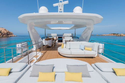 Flybridge of a yacht with bar and sun pads during a yacht charter vacation