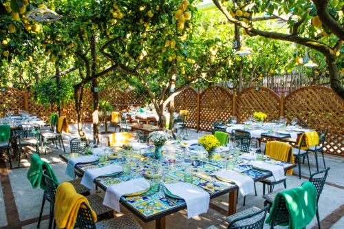 Tables set up under the lemon trees at the Da Paolino restaurant in Capri