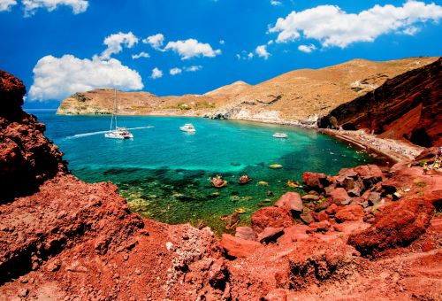 The Red Beach with its red volcanic cliffs and turquoise waters on the island of Santorini in Greece
