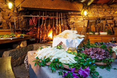 Barbecue, assorted cheeses and cold meats at the Lu Stazzu restaurant on the Costa Smeralda