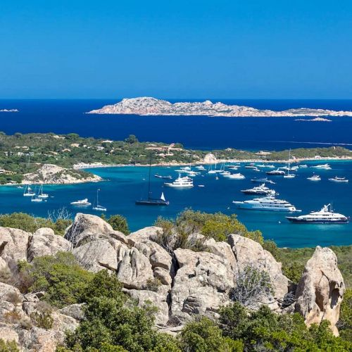 The bay of Cala di Volpe in Sardinia with luxury charter yachts at anchor