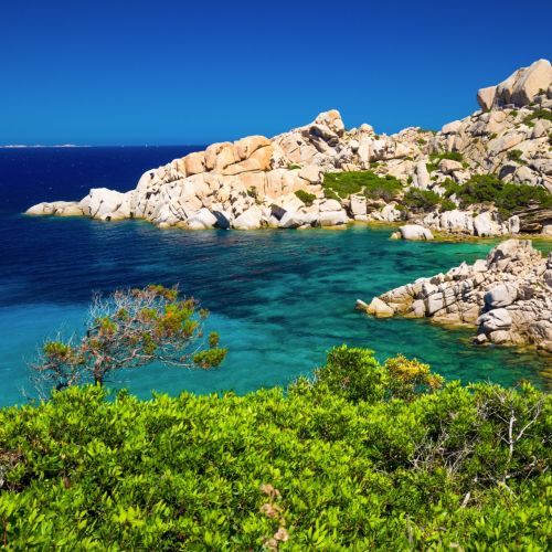 Rock formation and turquoise waters in the archipelago of La Maddalena in Sardinia