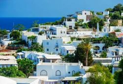 A residential area with white houses on the island of Panarea in Sicily