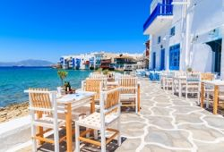 A seafront Greek taverna restaurant on the island of Mykonos in Greece