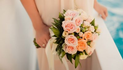 Close-up of a bouquet of pink roses during  a wedding celebration on a yacht charter