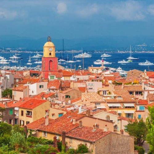 The village of St Tropez and the bay with charter yachts at anchor