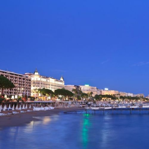 Night view of the city of Cannes with the famous Boulevard de La Croisette and the Carlton Hotel
