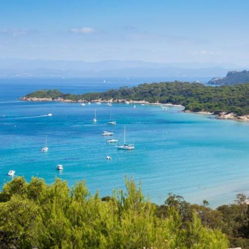 A superb bay anchorage with charter yachts at anchor on the island of Porquerolles in the south of France