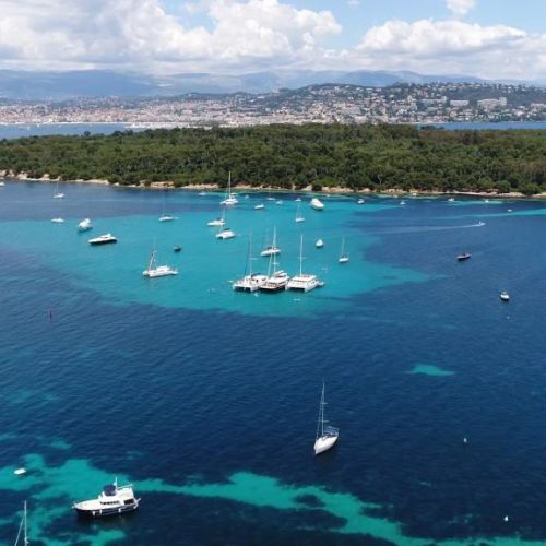 The Lerins Islands in the bay of Cannes with charter yachts at anchor