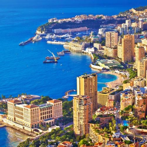 Aerial view of Monaco and its buildings with the entrance of Port Hercule