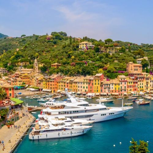 The colourful village of Portofino with luxurious yachts moored in the marina