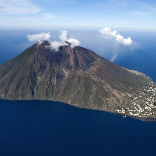 The island of Stromboli and its active volcano in the Aeolian Islands in Sicily