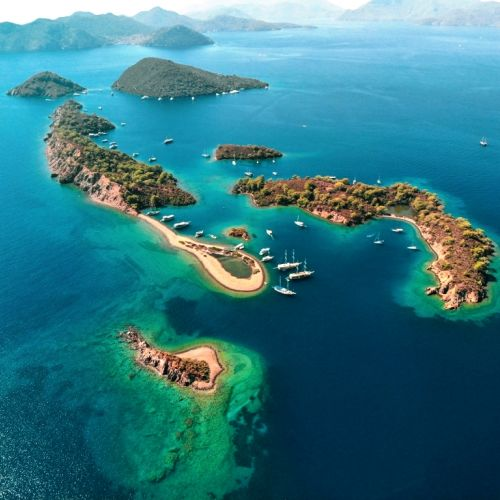 Paradise islands off Göcek in Turkey with charter yachts at anchor