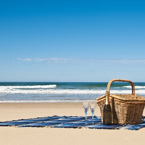 A picnic hamper on a beautiful beach