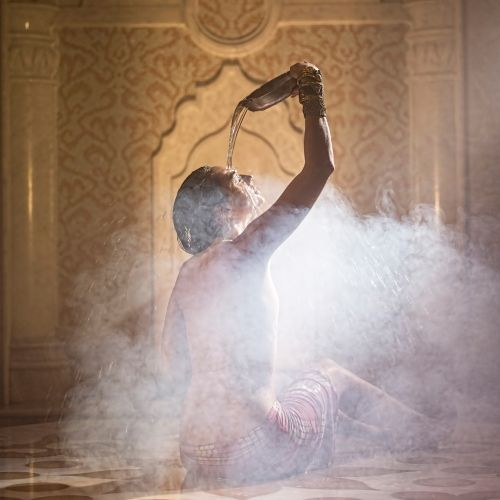 A woman enjoying a relaxing moment in a traditional hammam in Turkey