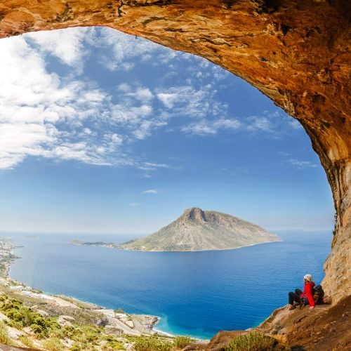 A hiker on the island of Kalymnos with its cliffs and spectacular scenery