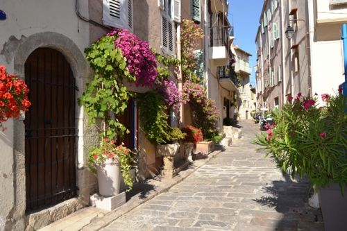 A street of Cannes old district Le Suquet during the summer