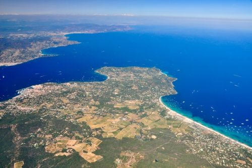 Panorama over the Gulf of St Tropez and the beach of Pampelonne with charter yachts