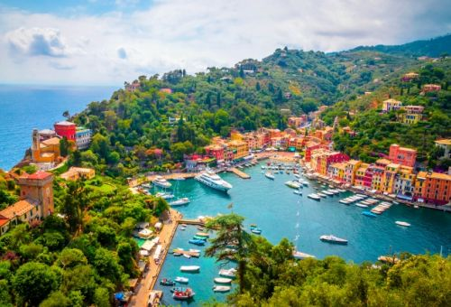 Aerial view of the colourful marina of Portofino in Italy with yachts moored in the port
