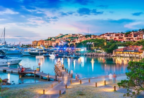 The marina of Porto Cervo in Sardinia at nightfall with moored yachts