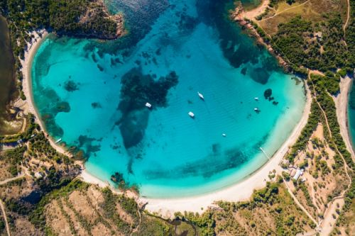 Aerial view of the superb sandy beach of Rondinara with its turquoise waters in Corsica
