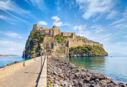 The island of Ischia with its medieval castle in the bay of Naples in Italy