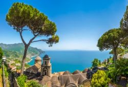 Panoramic view of the village of Ravello with its church, pine trees and the Mediterranean sea