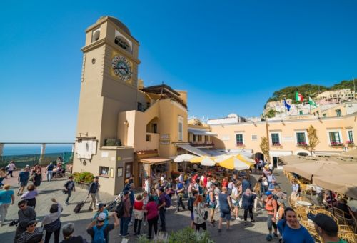 The Piazzeta of Capri on a beautiful summer's day with people on café terraces