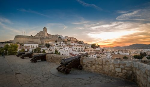 The fortress of Ibiza and the place of the cannons at sunset