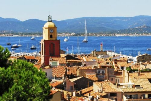 Panorama of the village of St Tropez with its bell tower and yachts at anchor in the bay