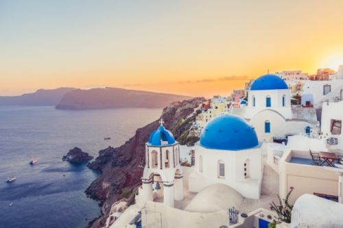 Sunset in Oia on the island of Santorini, one of the best honeymoon destinations in the Mediterranean