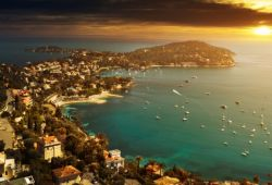 The sun sets on the peninsula of Saint-Jean-Cap-Ferrat in the south of France