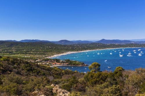 The beach of Pampelonne in Ramatuelle near St Tropez with yachts at anchor