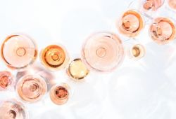 A collection of wine glasses filled with rosé wine