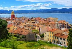 The colourful village of St Tropez with its bell tower under a beautiful blue sky