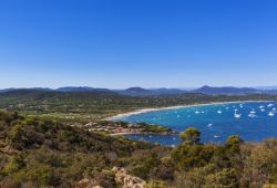 The superb sandy beach of Pampelonne near St Tropez with charter yachts at anchor