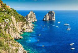 The Faraglioni are rock formations located off the island of Capri