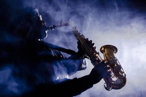 A saxophonist playing during a concert at the Monte-Carlo Jazz Festival