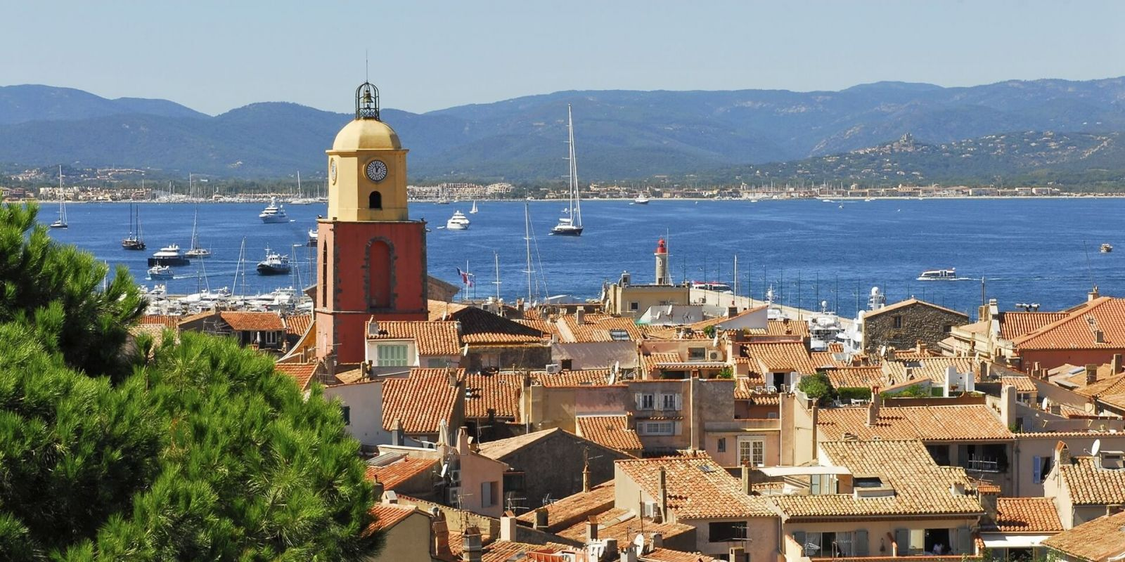 https://www.talamare.com/medias/View of St Tropez village with yachts at anchor