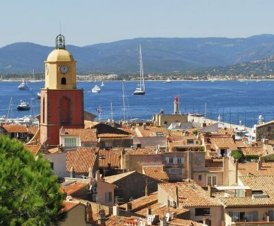 View of St Tropez village with yachts at anchor