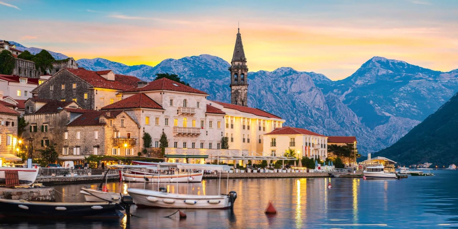 https://www.talamare.com/medias/Sunset over the historic town of Perast in the Bay of Kotor during a Montenegro yacht charter