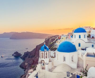 The beautiful coastal town of Oia on Santorini island in Greece with white buildings and blue domes