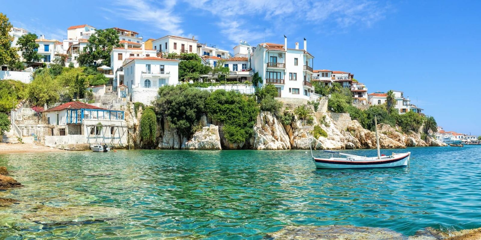 https://www.talamare.com/medias/The old port of Skiathos under a beautiful blue sky in the Sporades Islands in Greece