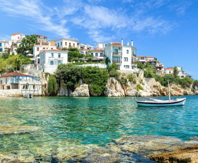 The old port of Skiathos under a beautiful blue sky in the Sporades Islands in Greece