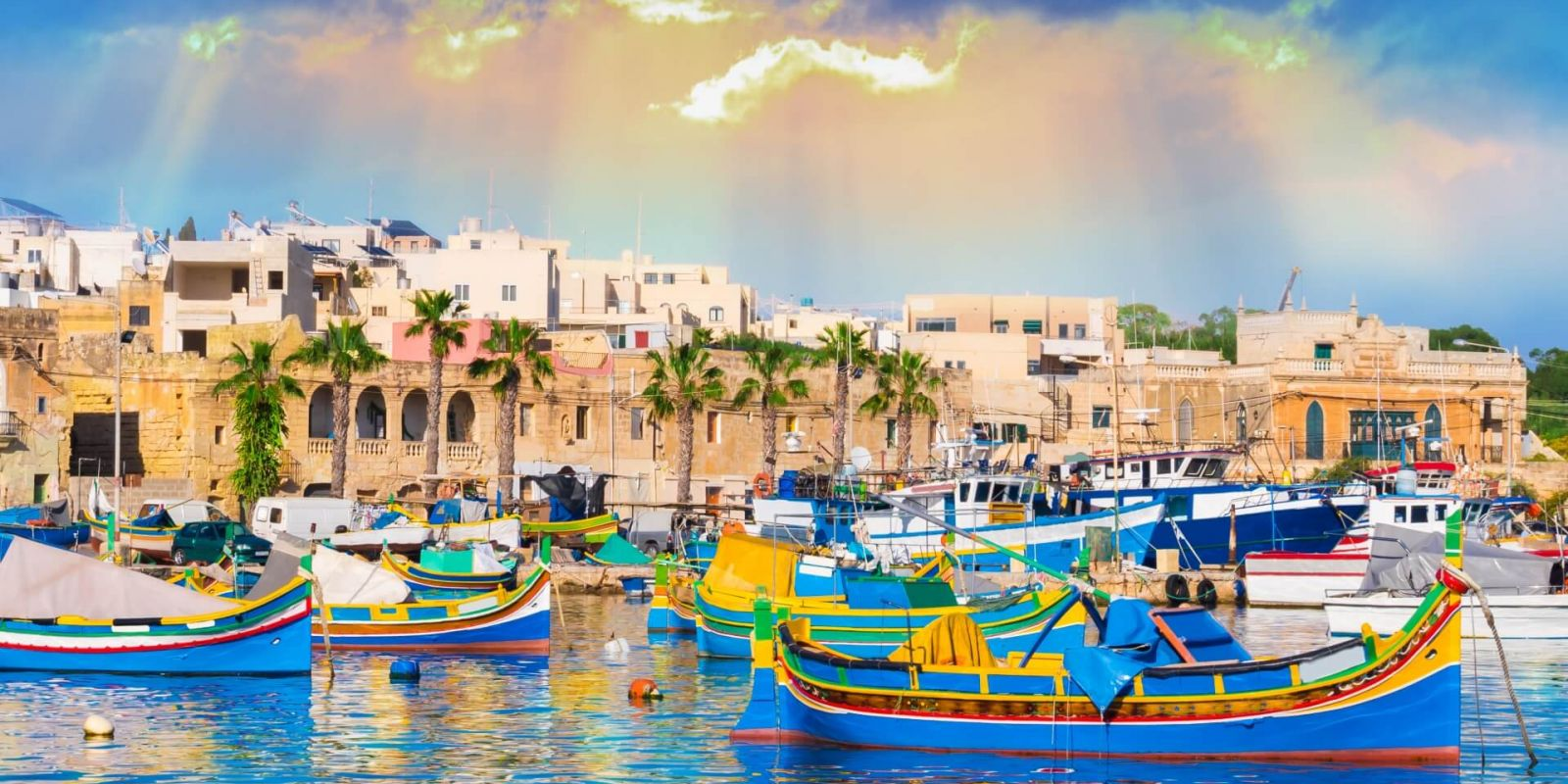 https://www.talamare.com/medias/Colourful boats in the old fishing village of Marsaxlokk on the island of Malta