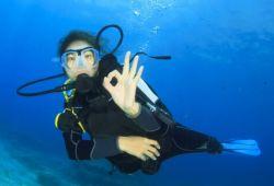 Woman scuba diving during a Mediterranean yacht charter