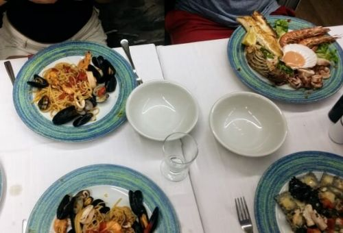 Seafood and pasta dishes in a Cinque Terre restaurant in Italy