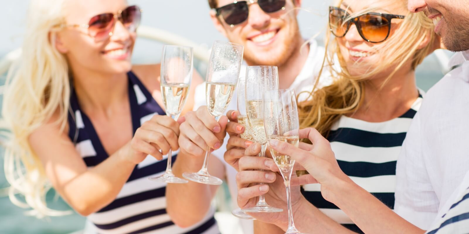 https://www.talamare.com/medias/A group of charter guests drinking champagne on the deck of a luxury yacht for over 12 people