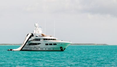 A yacht available for charter with her collection of water toys