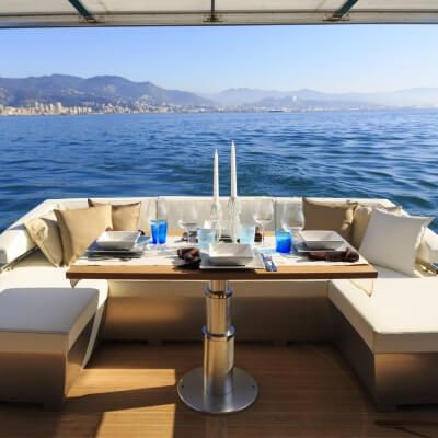 A table set up for lunch on the aft deck of a luxury charter yacht available on the French Riviera